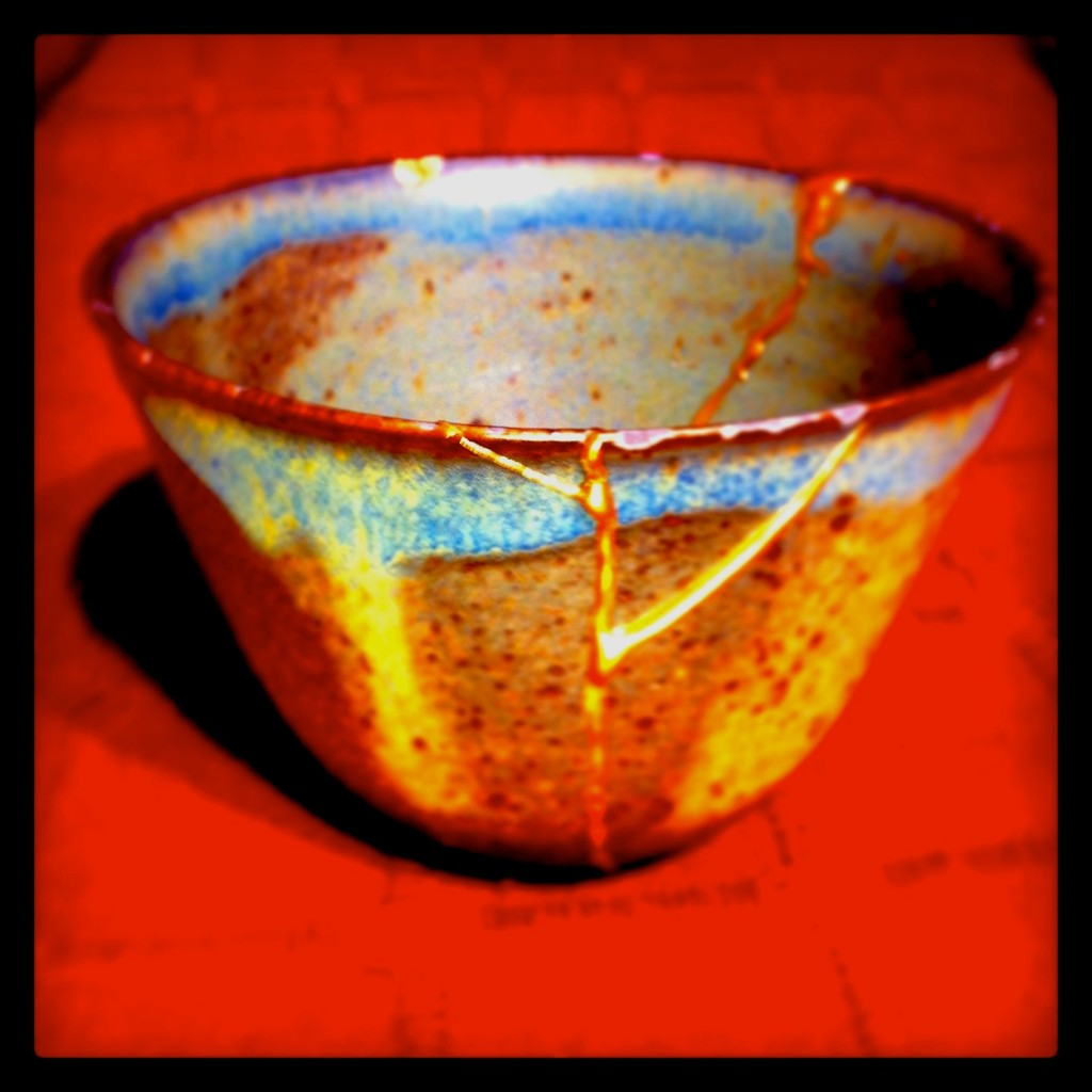 A broken bowl repaired using Kintsugi, the Japanese art of gold joinery