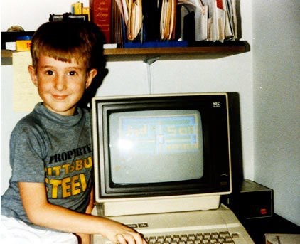 Robert as a child proudly displaying his efforts on an Apple IIe computer in the mid 1980s